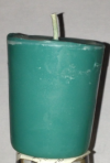 Teal votive candle, $2.00, by Fretzy's Candles. Portion of proceeds go to Ovarian Cancer Research Fund.